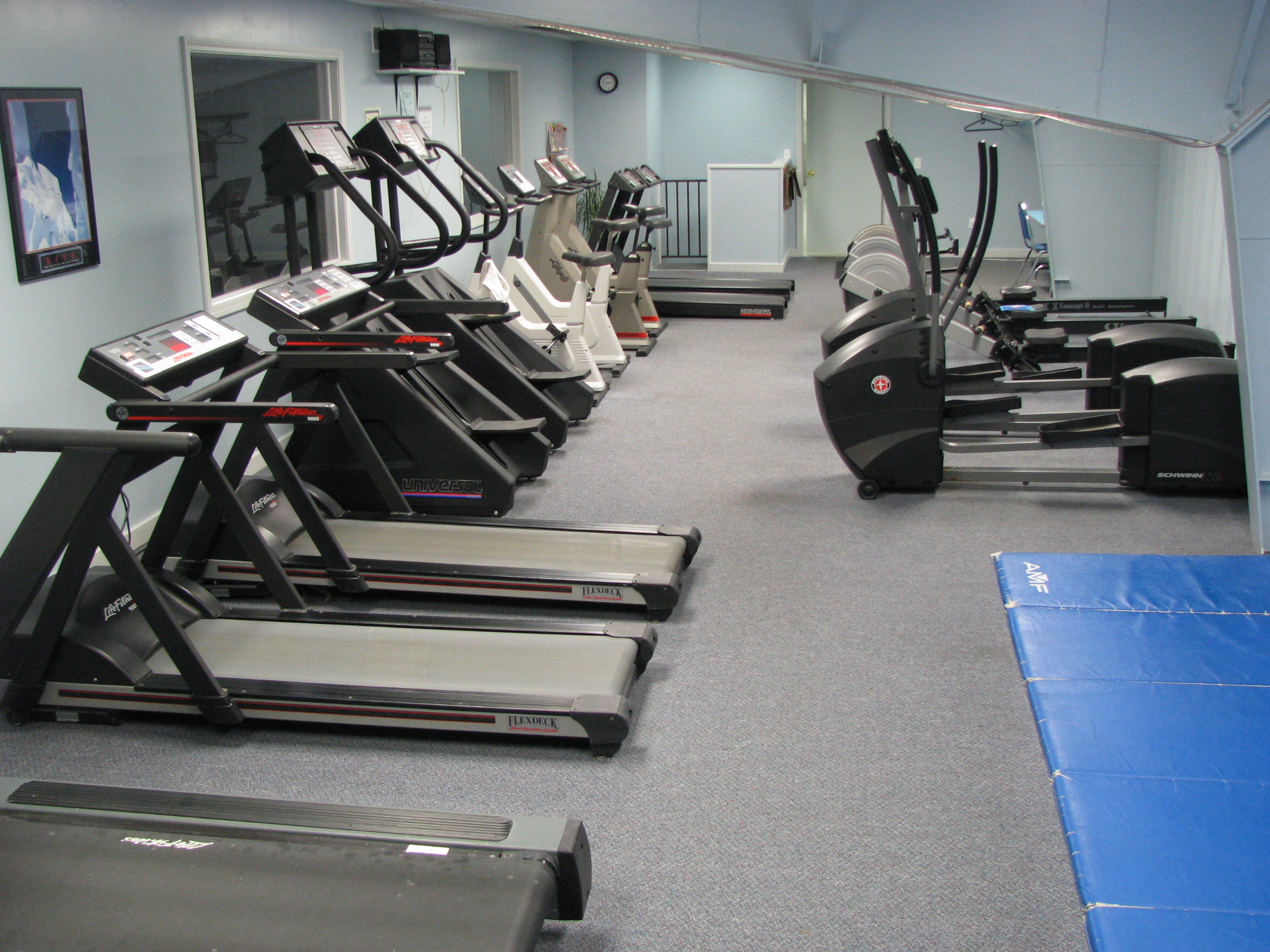 adult fitness at summit gym weight room cardio gym cardio gym
